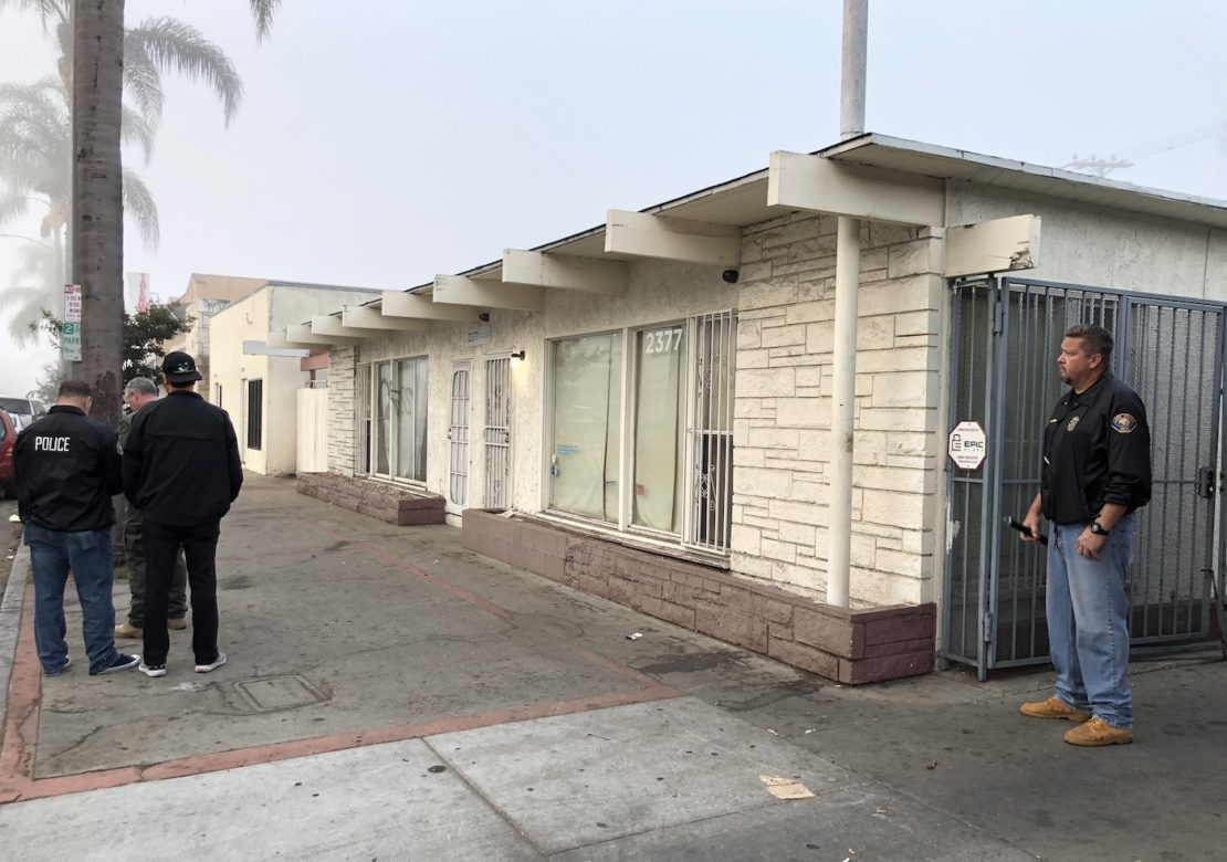 Police outside a suspected illegal gambling parlor on Pacific Avenue at Burnett Street. Photo by Jeremiah Dobruck.